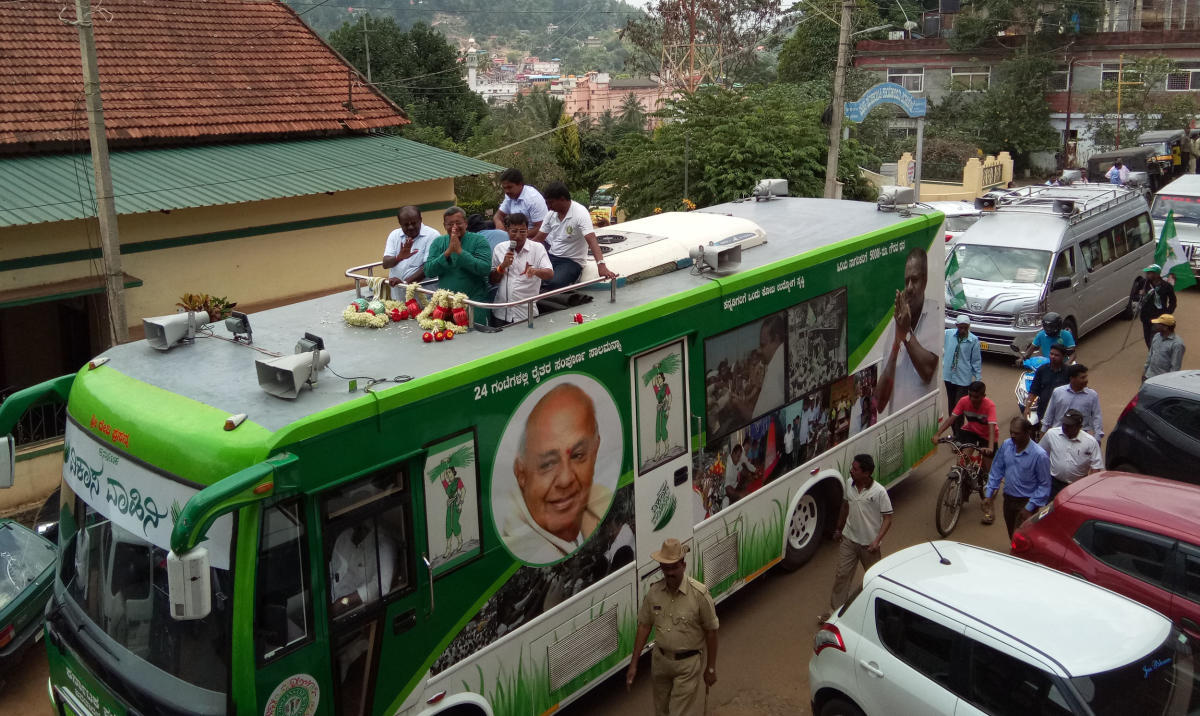 JD(S) State President H D Kumaraswamy and JD (S) candidate M Sanketh Poovaiah take part in a roadshow in Virajpet.