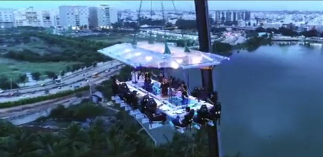 A dining deck lifted by a crane with a breath-taking view of the Nagawara Lake, Manyata Techpark and Bangalore's Green Cover. Screen Grab