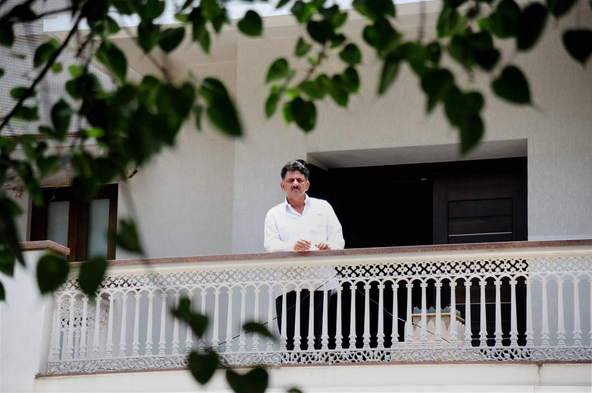 The then energy minister of Karnataka D K Shivakumar stands in the balcony of his residence in Bengaluru during an Income Tax raid in 2017. (PTI File Photo)