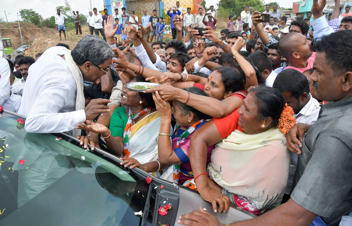 Chief Minister Siddaramiah along with others takes out a road show Chamundeshwari Assemble segment, in Mysuru on Monday. - PHOTO / DH PV PHOTOS