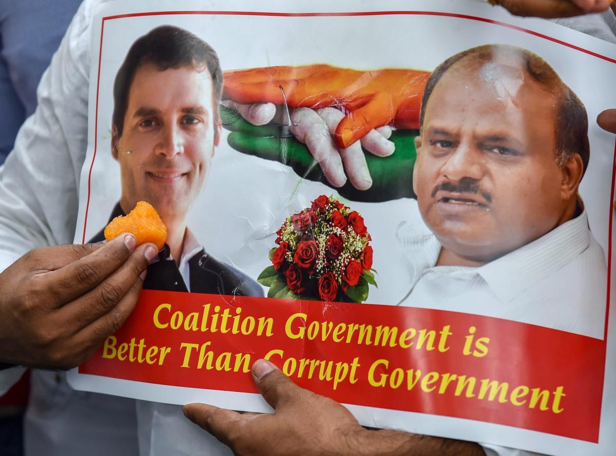 A poster of Congress president Rahul Gandhi and JD(S) chief HD Kumaraswamy after Karnataka Chief Minister BS Yeddyurappa announced his resignation, in New Delhi. PTI file photo
