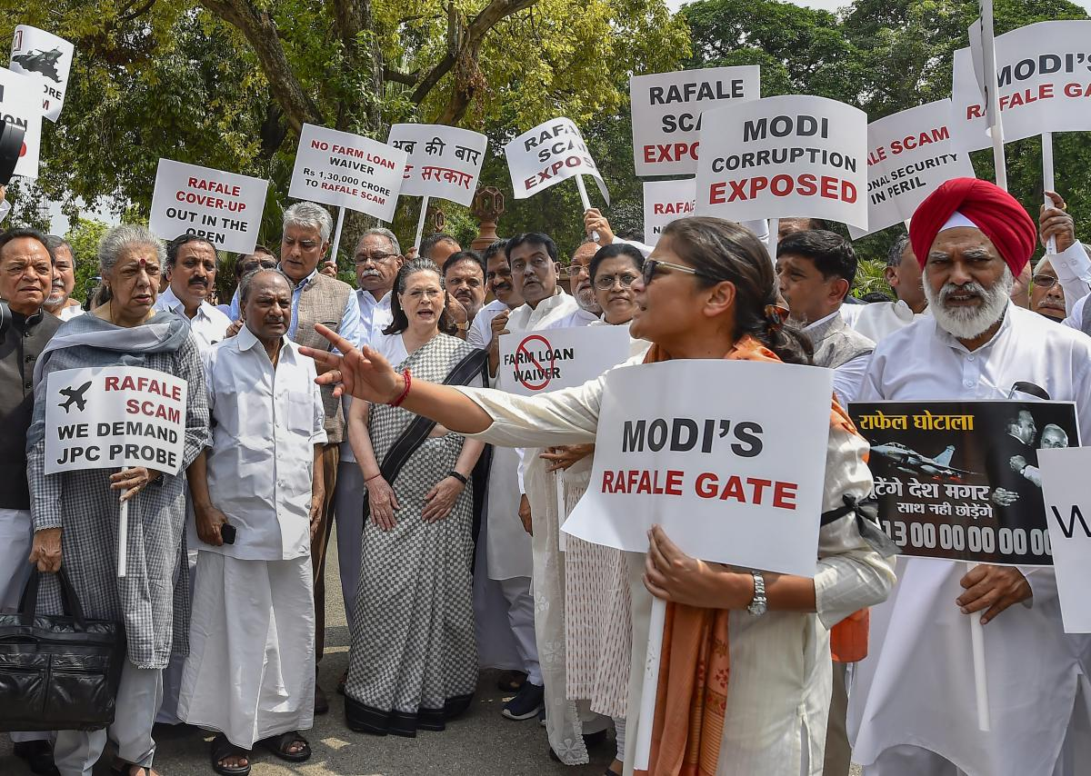 UPA chairperson Sonia Gandhi along with other Opposition party leaders raise slogans during a protest against the Union government over Rafale deal issue, at Parliament House in New Delhi on Friday. PTI
