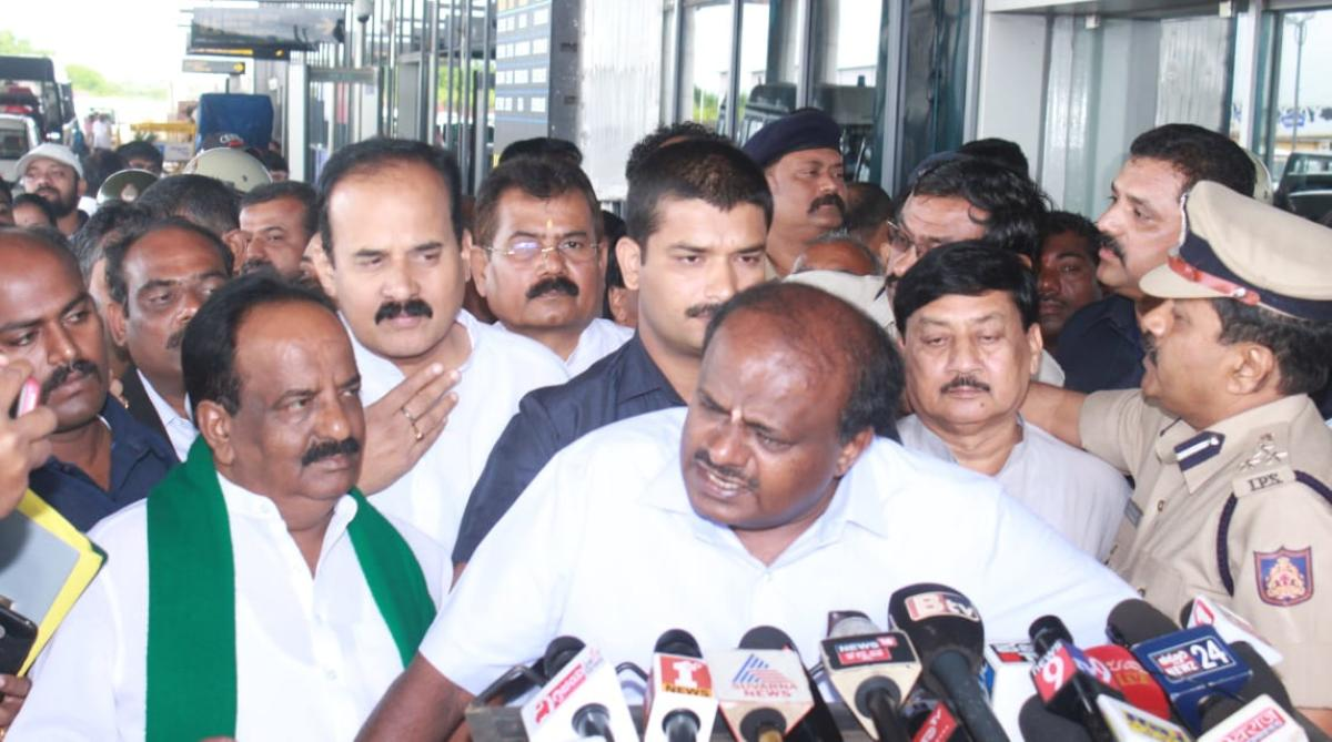 Chief Minister H D Kumaraswamy addresses reporters at the Hubballi airport on Sunday. DH photo.