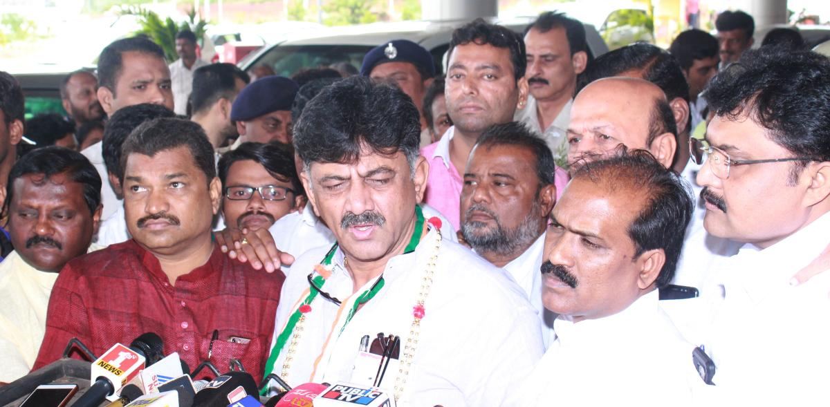 Water Resource Minister D K Shivakumar speaks to media persons at Hubballi Airport on Sunday.