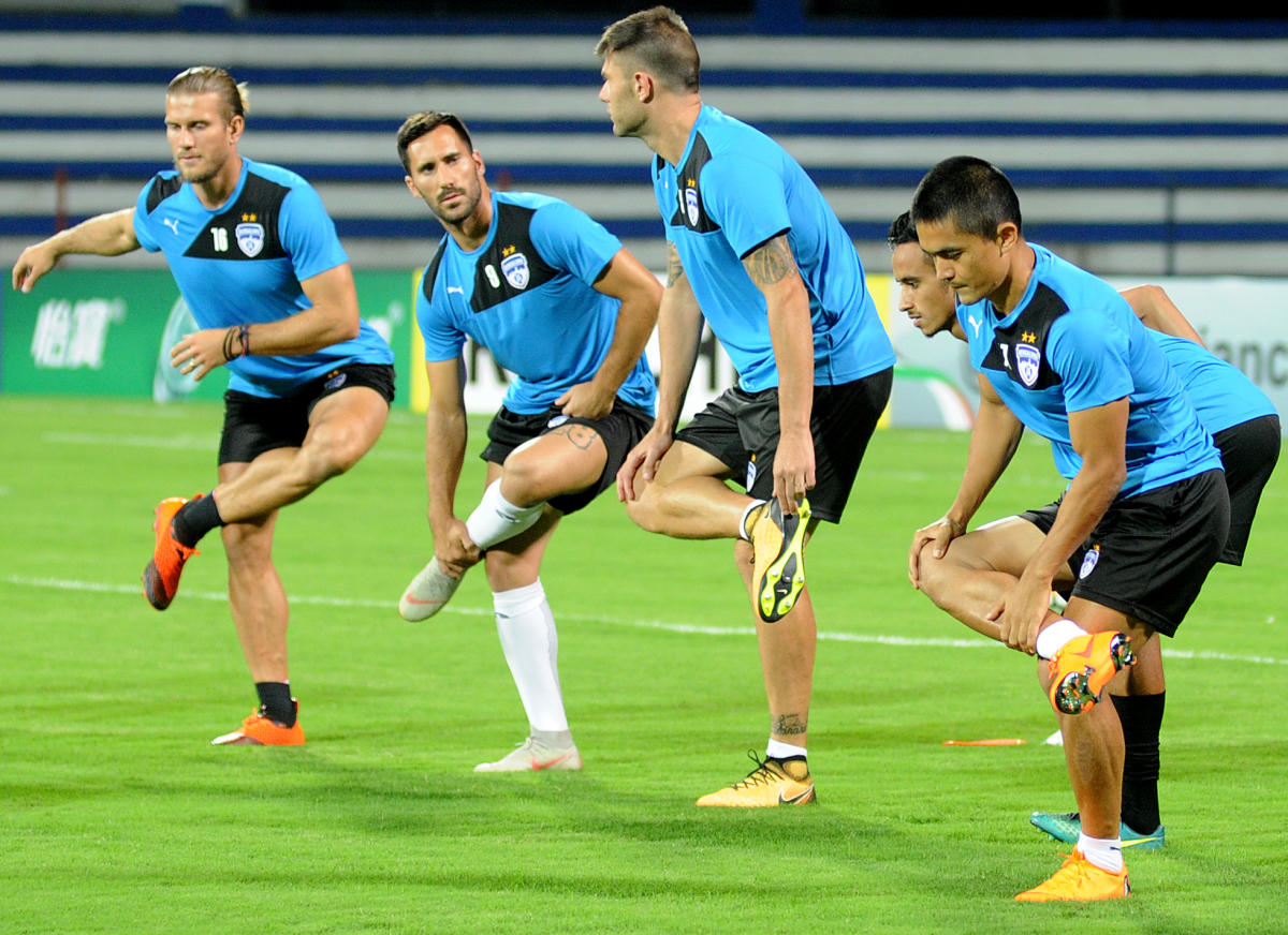 IN READINESS Bengaluru FC players warm-up ahead of a practice session on the eve of their AFC Cup clash against Altyn Asyr. DH Photo/ Srikanta Sharma R