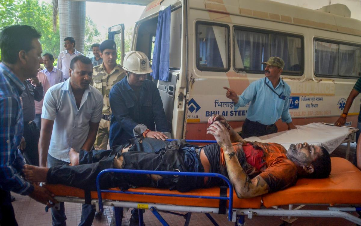 Injured employees being taken for treatment after a blast at the Bhilai Steel Plant of state-owned SAIL in Durg. PTI Photo