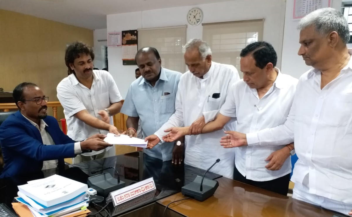 JD(S) candidate Madhu Bangarappa submits nomination papers to Deputy Commissioner K A Dayananda in Shivamogga on Tuesday. Chief Minister H D Kumaraswamy, former ministers Kagodu Thimmappa, Kimmane Ratnakar and MLA B K Sangamesh are seen.