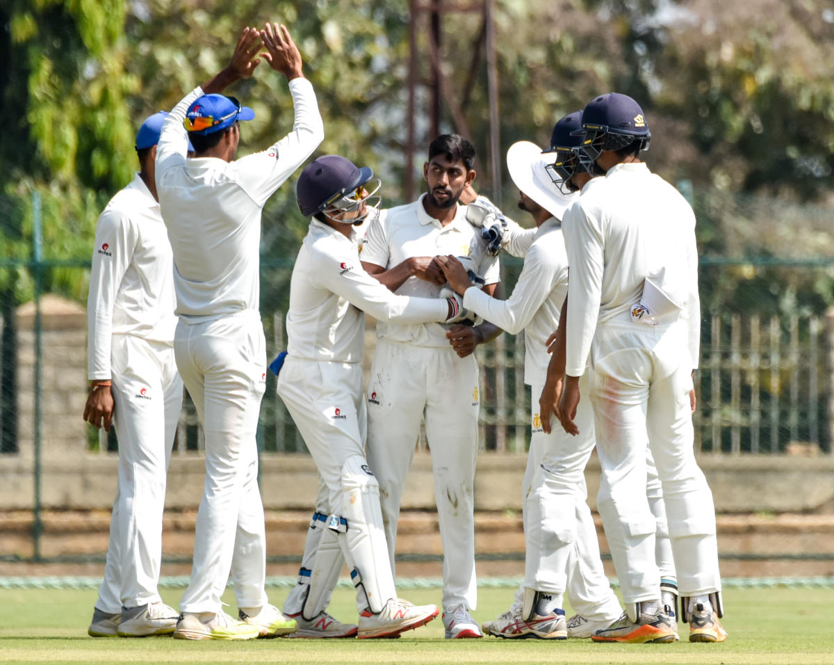 LEFT-ARM LETHAL: J Suchith (centre) celebrates with team-mates after taking a wicket. DH Photo/ Savitha B R
