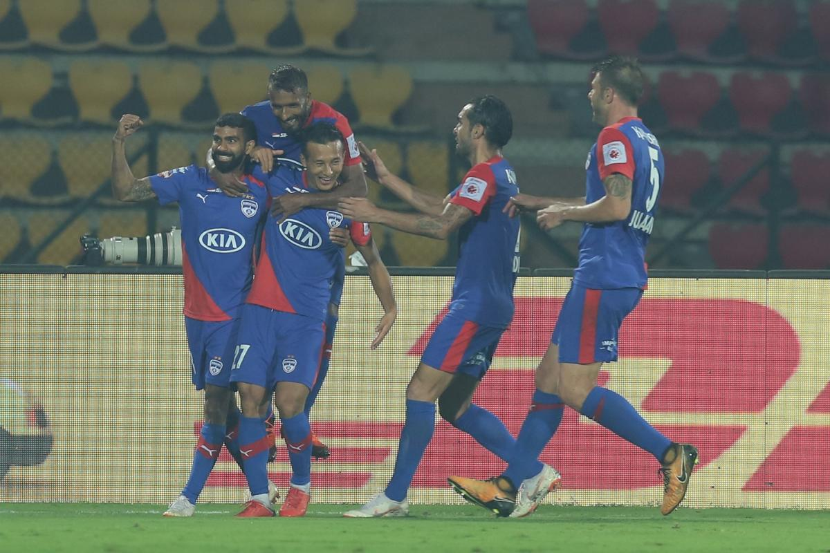 SAVIOUR: Chencho Gyeltshen of Bengaluru FC (second from right) celebrates with team-mates after scoring his team's equaliser against NorthEast United FC. ISL MEDIA