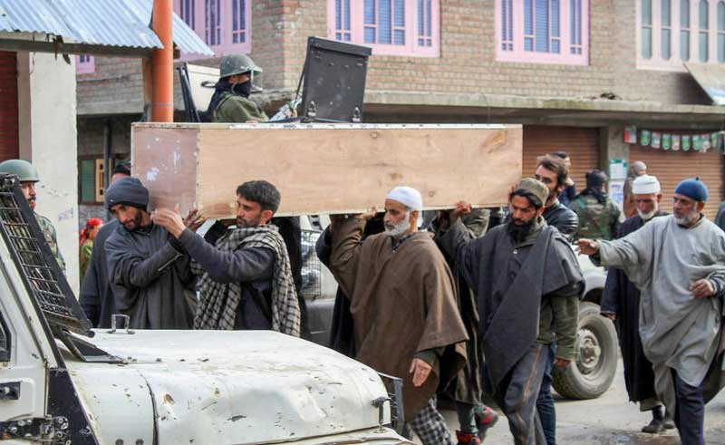 People carry the mortal remains of SPO Khushboo Jan, who was shot dead by militants at her home, in Shopian. (PTI Photo)