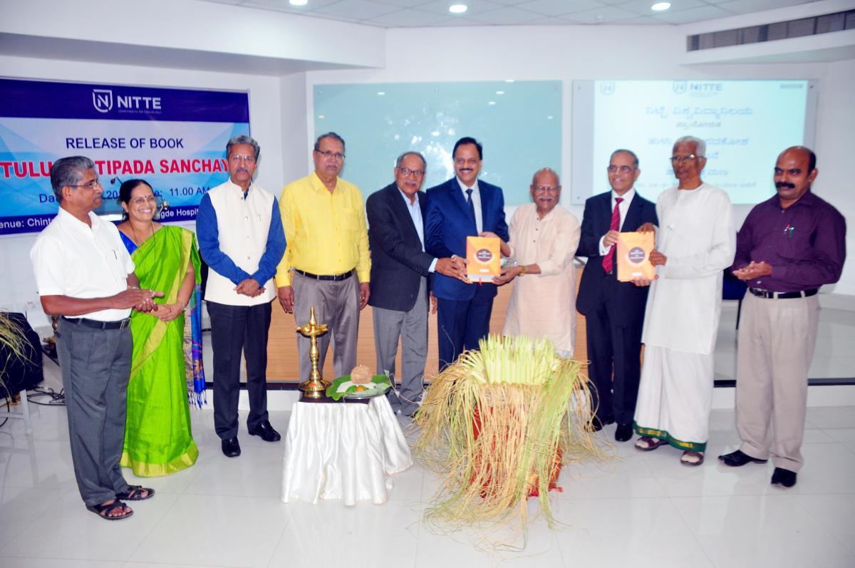 Bangalore University Professor Emeritus Dr Hampa Nagarajaiah releases Tulu cognate dictionary.