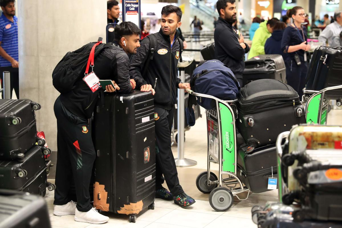 HOME BECKONS: Members of the Bangladesh cricket team check into Christchurch Airport on Friday. AFP