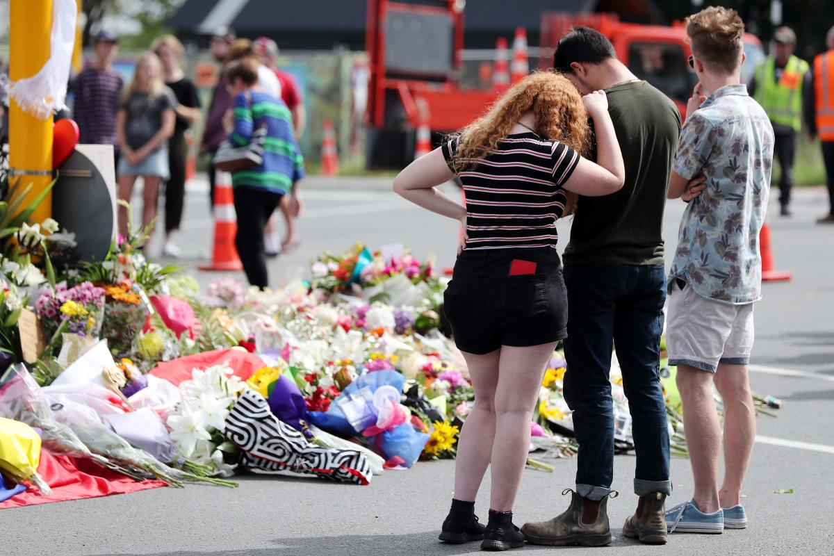 Residents pay their respects by placing flowers for the victims of the mosques attacks in Christchurch. AFP Photo