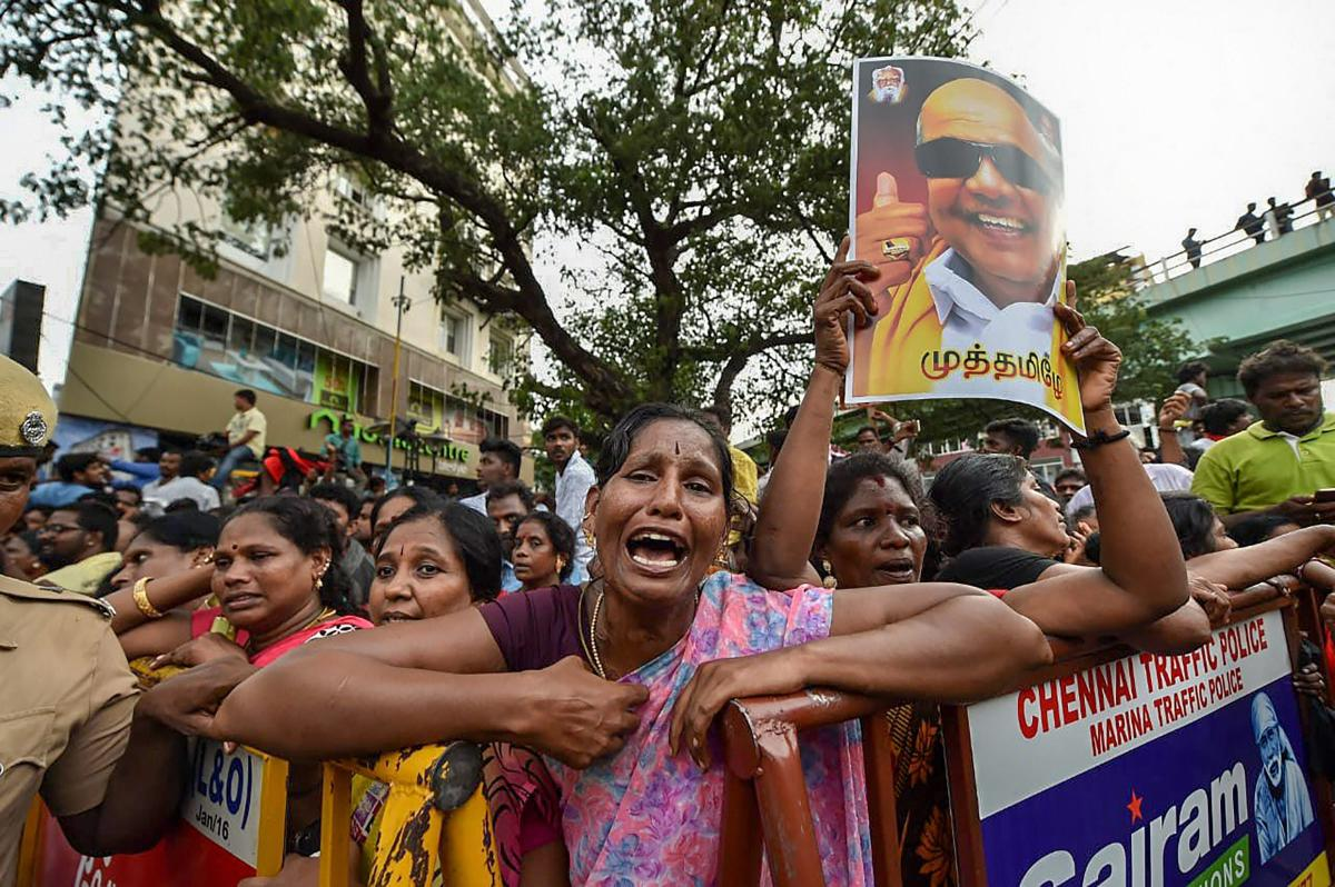 DMK supporters react after the party president M Karunanidhi passed away, in Chennai on Tuesday (PTI Photo/R Senthil Kumar)