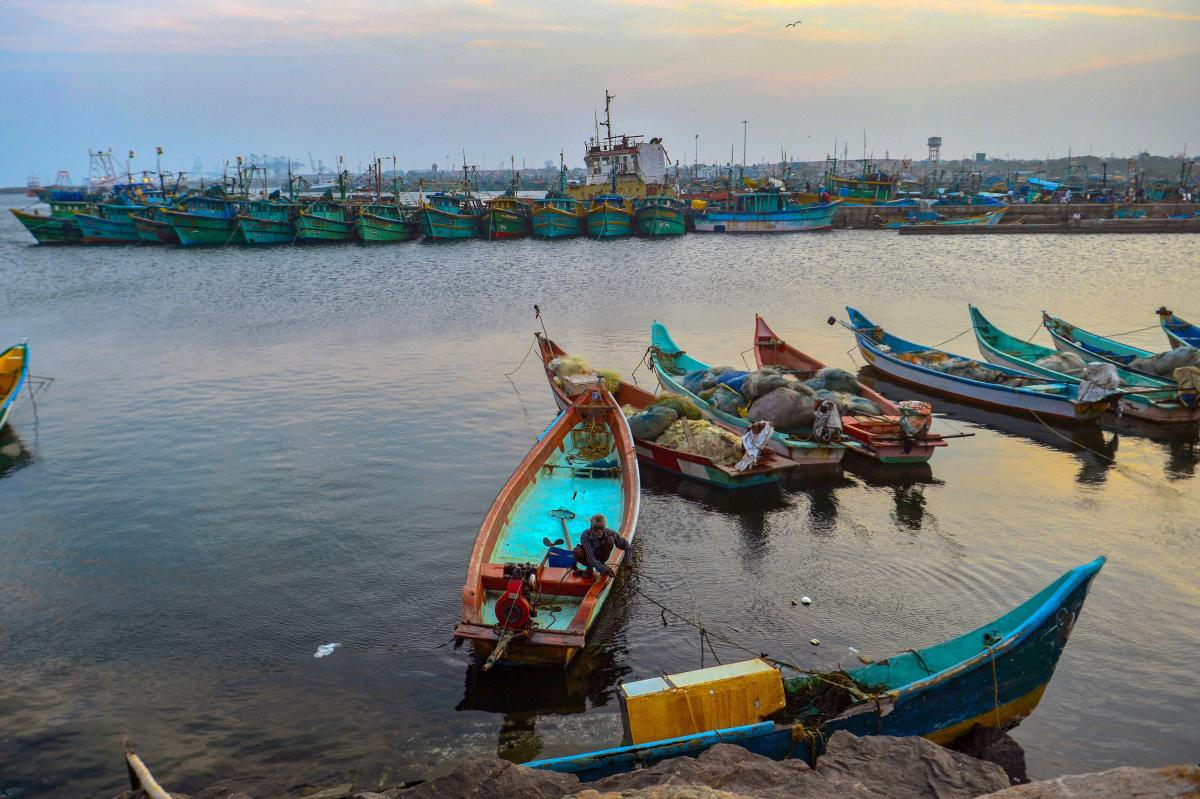 A fishermen parks his boat at fishing harbor as a part of precautionary measures in view of cyclonic storm 'Gaja', in Chennai, on Wednesday. PTI
