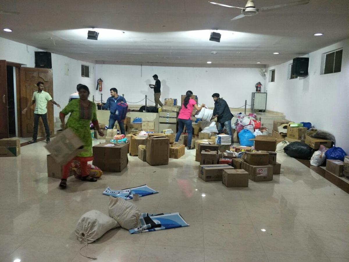Members of The Blue Umbrella packing relief material in the city for those affected by Cyclone Gaja in Tamil Nadu.