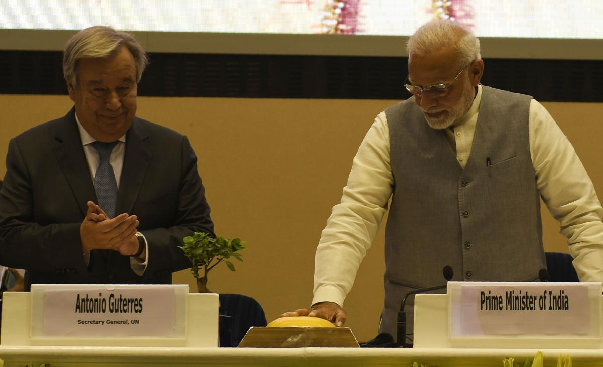 Prime Minister Narendra Modi (R) and United Nations Secretary General Antonio Guterres (L) gesture during the inaugural ceremony of the '2nd Global RE-INVEST India-ISA Partnership Renewable Energy Investors Meet & Expo' in New Delhi on Tuesday. AFP