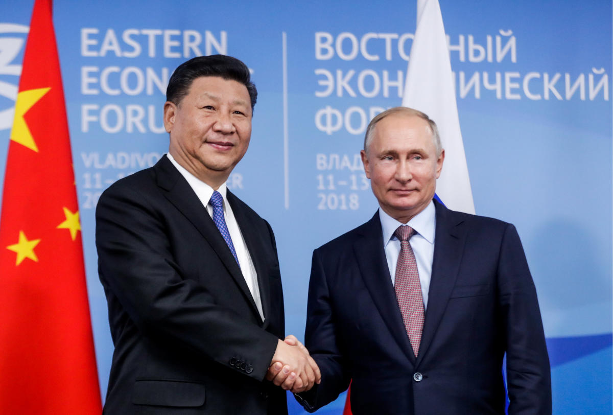 Russian President Vladimir Putin shakes hands with Chinese President Xi Jinping during their meeting on the sidelines of the Eastern Economic Forum in Vladivostok, Russia on September 11, 2018. REUTERS