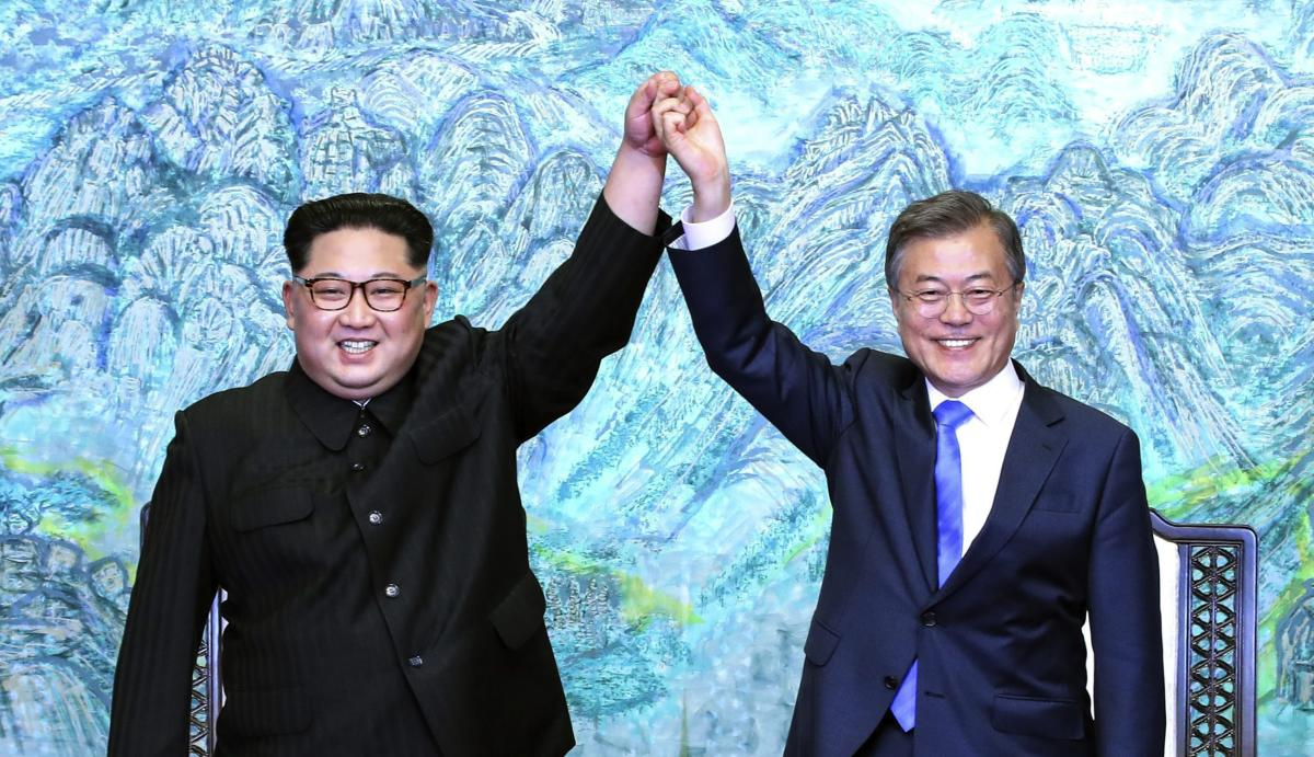 North Korean leader Kim Jong Un, left, and South Korean President Moon Jae-in raise their hands after signing a joint statement at the border village of Panmunjom in the Demilitarized Zone, South Korea, Friday, April 27, 2018. AP/PTI Photo
