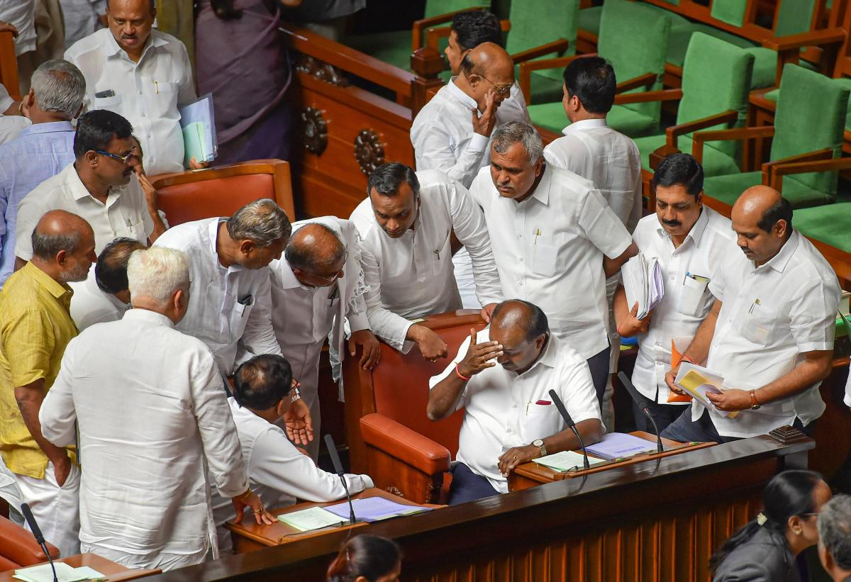 Bengaluru: Karnataka Chief Minister H D Kumaraswamy and his deputy G Parameshwara with other members during the Assembly session at Vidhana Soudha in Bengaluru, Monday, July 15, 2019. (PTI File Photo)