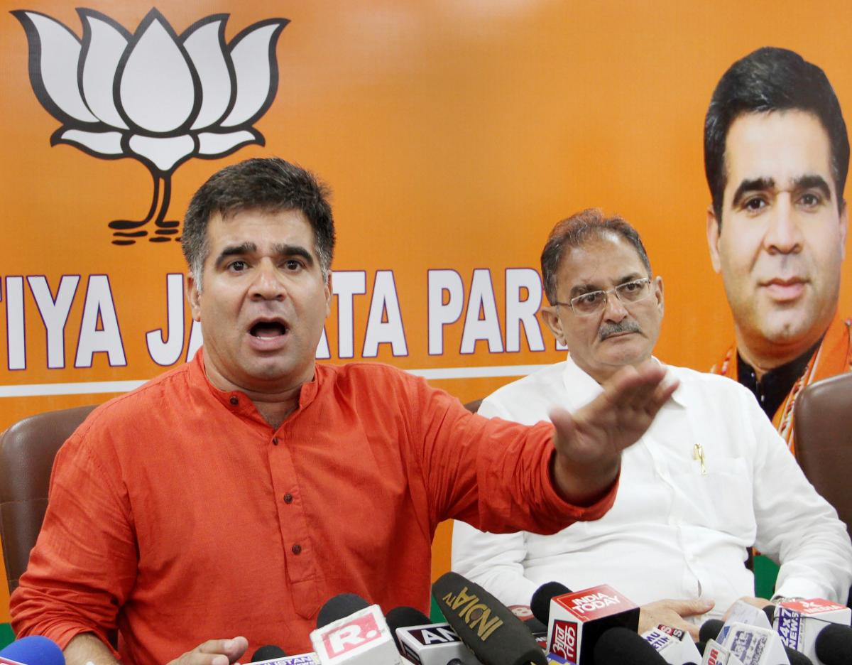 BJP State president Ravinder Raina (L) with former J & K dy chief minister Kavinder Gupta. (PTI File Photo)