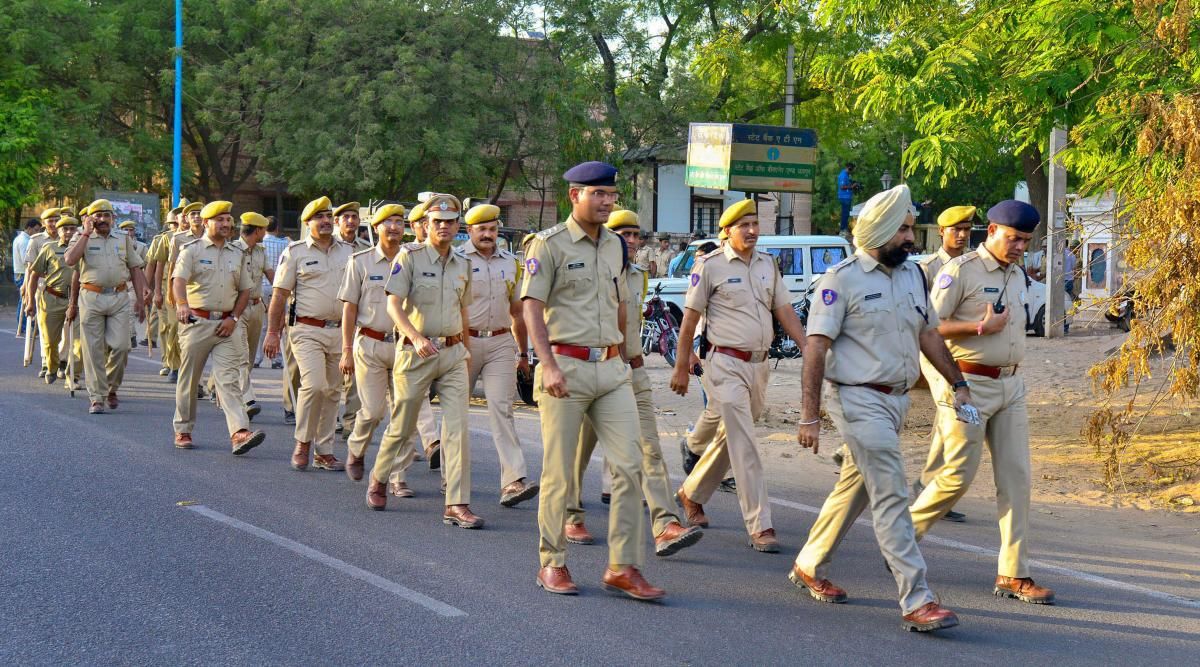 Police personnel march at Jodhpur Central Jail road as part of security arrangements, ahead of the court's verdict on Asaram sexual assault case, on Tuesday. (PTI Photo)