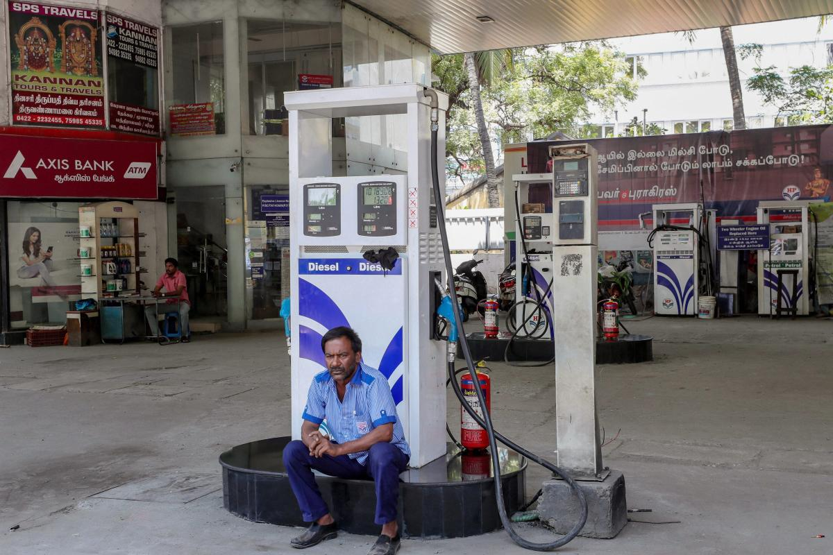 A security person guards a petrol pump in Coimbatore. PTI