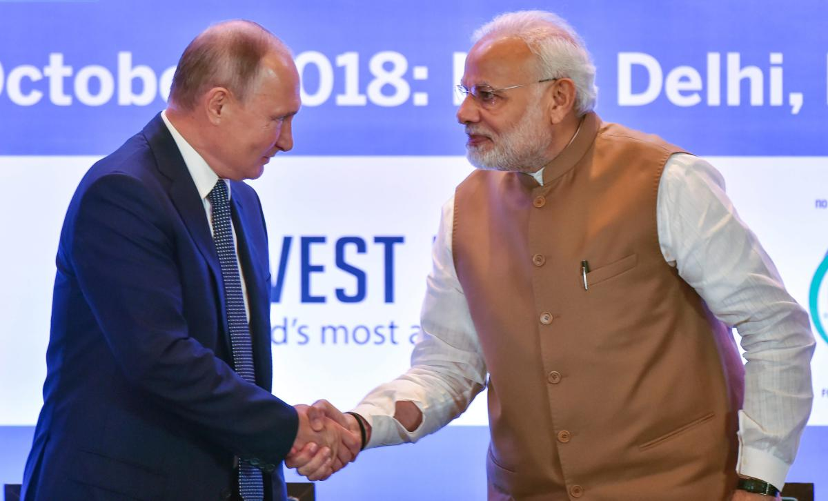 Prime Minister Narendra Modi shakes hands with Russian President Vladimir Putin during India-Russia Business Summit, in New Delhi, on Friday. PTI