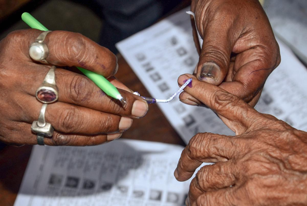 Polling officials put ink mark on a voter's finger. (PTI file pic for representation only)