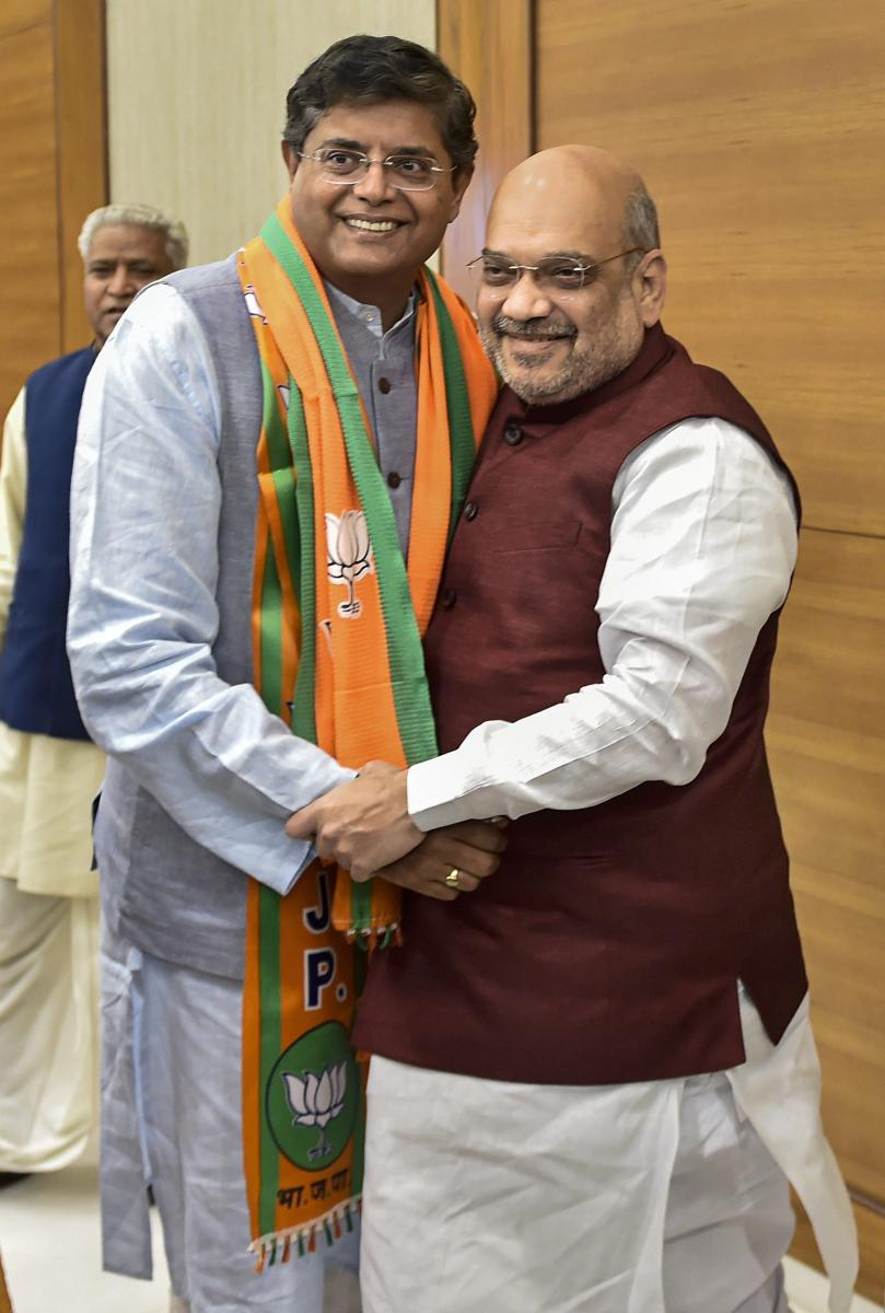 Former Biju Janata Dal MP Baijayant Jay Panda greets BJP national president Amit Shah after joining Bharatiya Janata Party. PTI file photo.