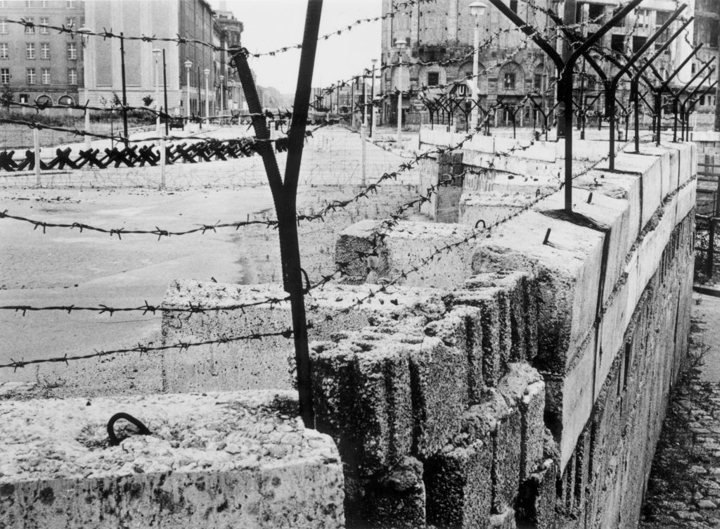 August 1962: A section of the Berlin Wall at Potsdamer Platz maintained by the German Democratic Republic between 1961 and 1989. (Photo by Central Press/Getty Images)