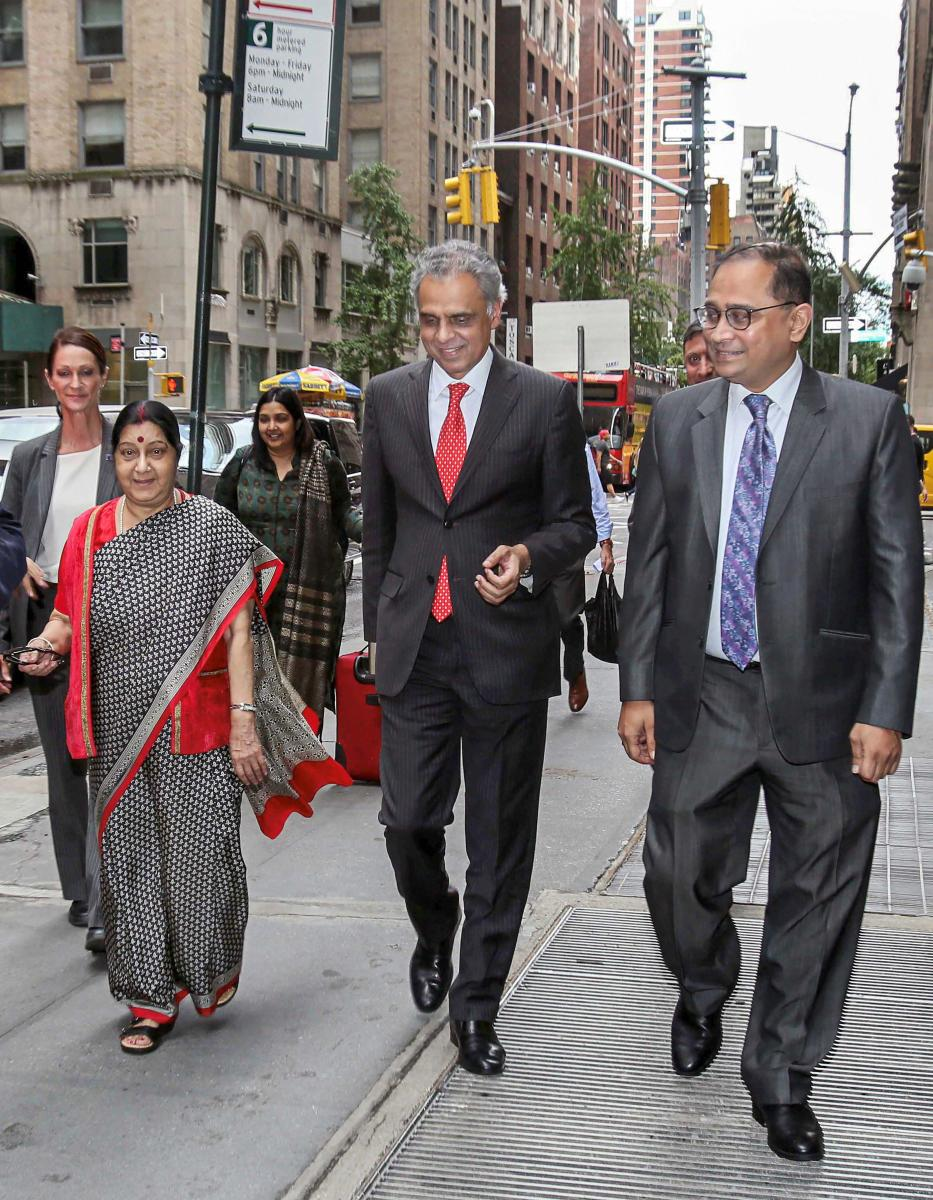 External Affairs Minister Sushma Swaraj being received by India's Permanent Representative to the UN Ambassador Syed Akbaruddin (C) and India's Consul-General in New York Ambassador Sandeep Chakravorty (R) on her arrival, in New York for UNGA. (PTI File P