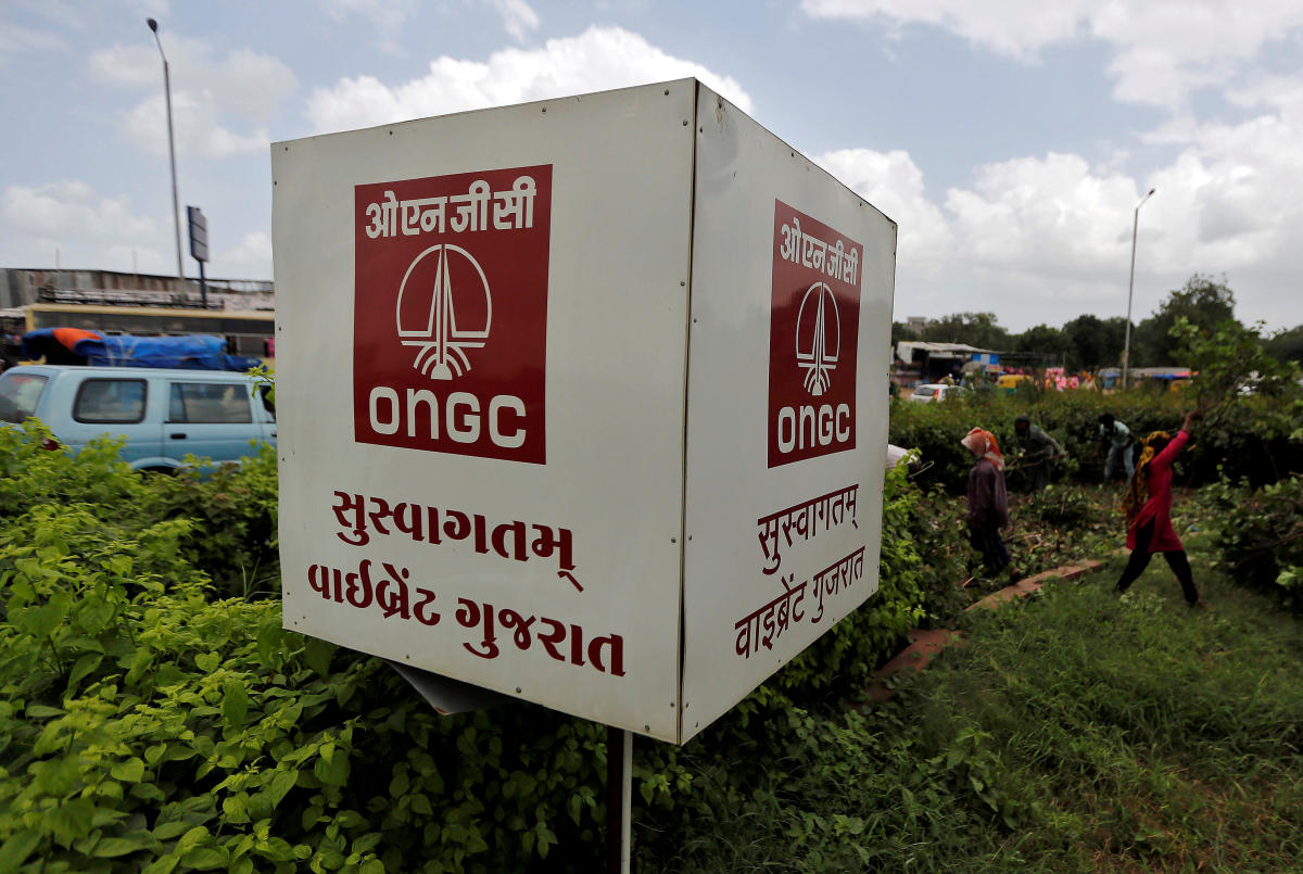 FILE PHOTO: The logo of Oil and Natural Gas Corp's (ONGC) is pictured along a roadside in Ahmedabad, India. REUTERS