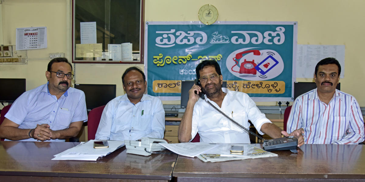 SCDCC Bank President M N Rajendra Kumar receives a call during the DH-PV phone in programme organised at DH-PV editorial office in Balmatta on Friday. Cooperative Societies Deputy Registrar B K Salim, Assistant Registrar Manjunath Singh and SCDCC Bank GM