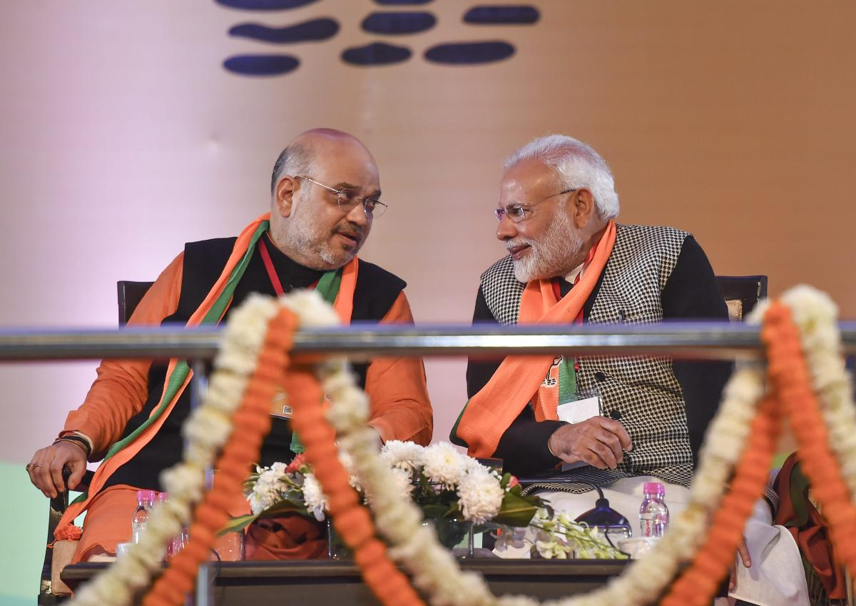Prime Minister Narendra Modi with BJP National President Amit Shah, on the first day of BJP National Executive Meet, at Ramlila Maidan in New Delhi. PTI