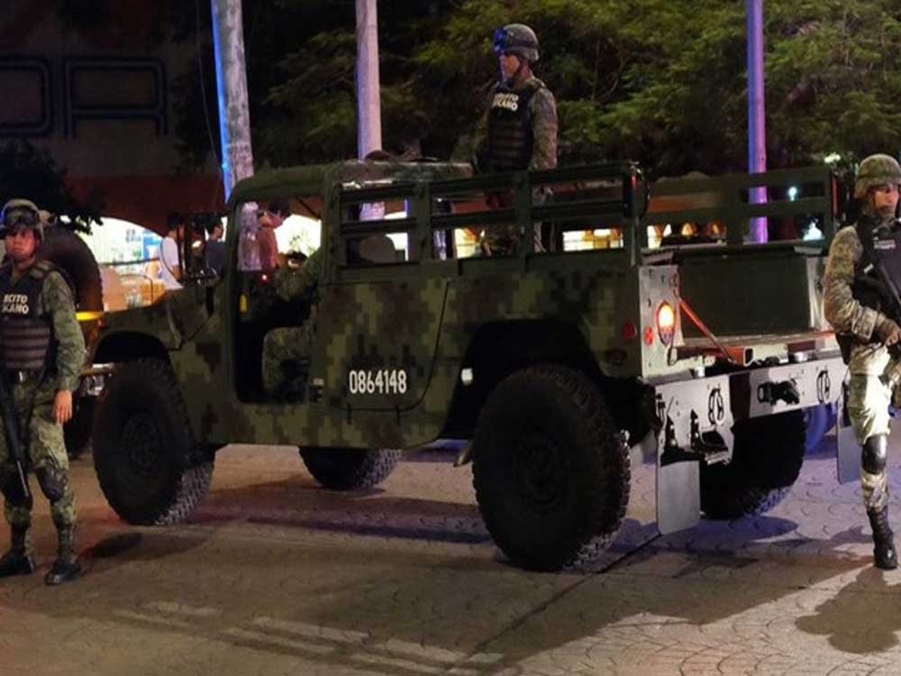 2 bodies found; shootout wounds 2 in Mexico resort of Cancun