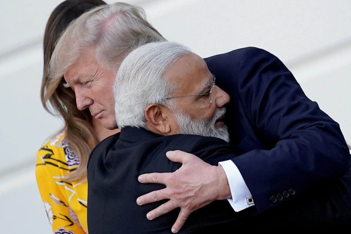 FILE PHOTO: India's Prime Minister Narendra Modi hugs U.S. President Donald Trump as he departures the White House after a visit, in Washington, U.S., June 26, 2017. REUTERS/Carlos Barria/File photo
