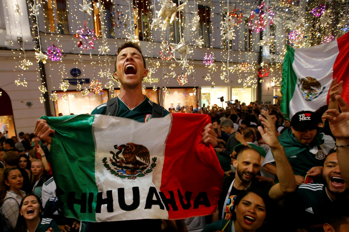 Mexico's fans celebrate victory of their team after the match. REUTERS Photo.