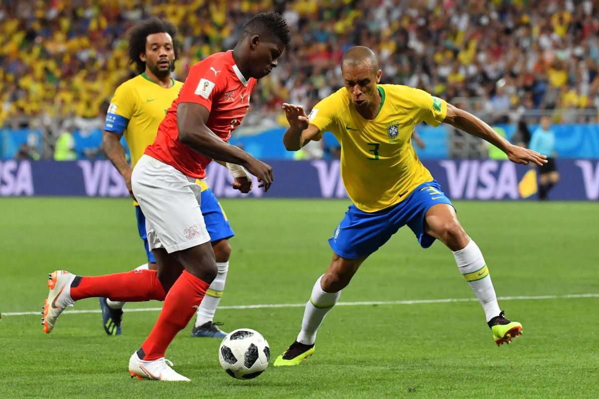 Switzerland's forward Breel Embolo and Brazil's defender Miranda compete for the ball during the Russia 2018 World Cup Group E football match. AFP PHOTO