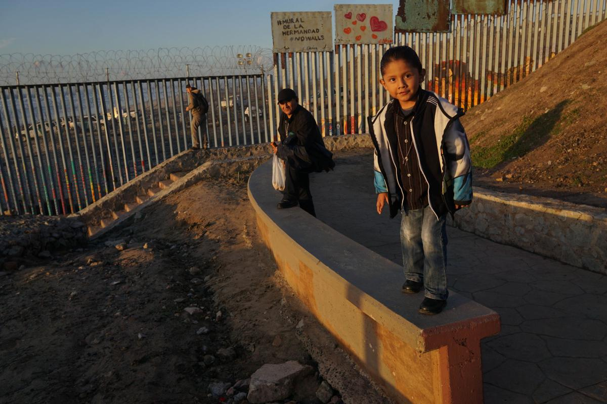 TIJUANA, MEXICO - JANUARY 06: Hector Sanchez, 6, at play along the U.S.-Mexico border wall in the Las Playas area on January 6, 2019 in Tijuana, Mexico. The U.S government is going into the third week of a partial shutdown with Republicans and Democrats a