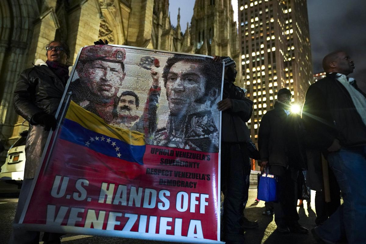 Demonstrators In Support Of Venezuelan President Maduro Protest Outside The Venezuelan Consulate In New York City. AFP