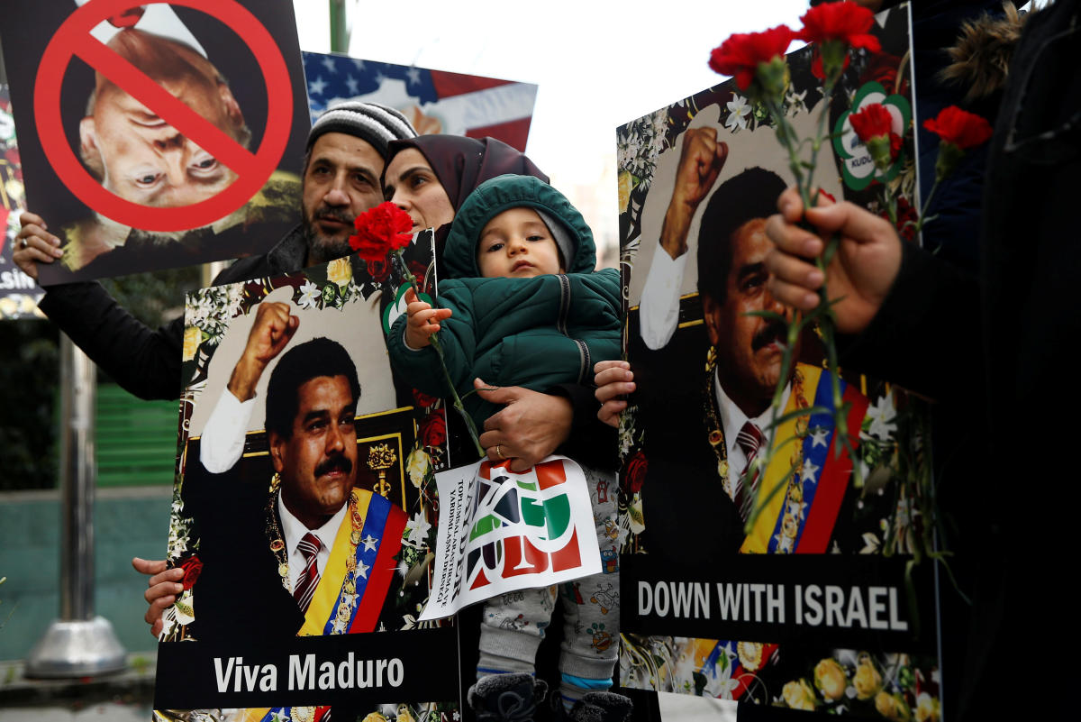 Protesters hold banners as they gather in support of Venezuelan President Nicolas Maduro's government in front of the Venezuelan Consulate in Istanbul. Reuters