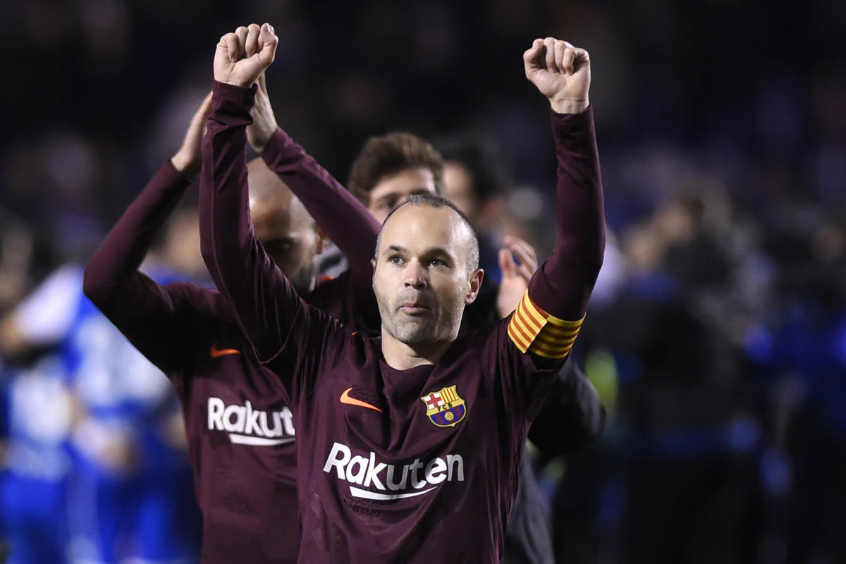 Legend: Barcelona's Andres Iniesta acknowledges the crowd after receiving a standing ovation from Deportivo Coruna fans at the Riazor stadium in Coruna on Sunday. AFP