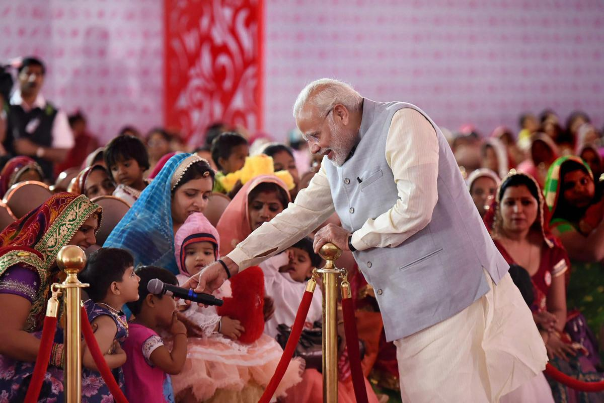 Prime Minister Narendra Modi interacts with the 'Beti Bachao, Beti Padhao' beneficiaries, on the occasion of International Women's Day in Rajasthan. (PTI file photo)