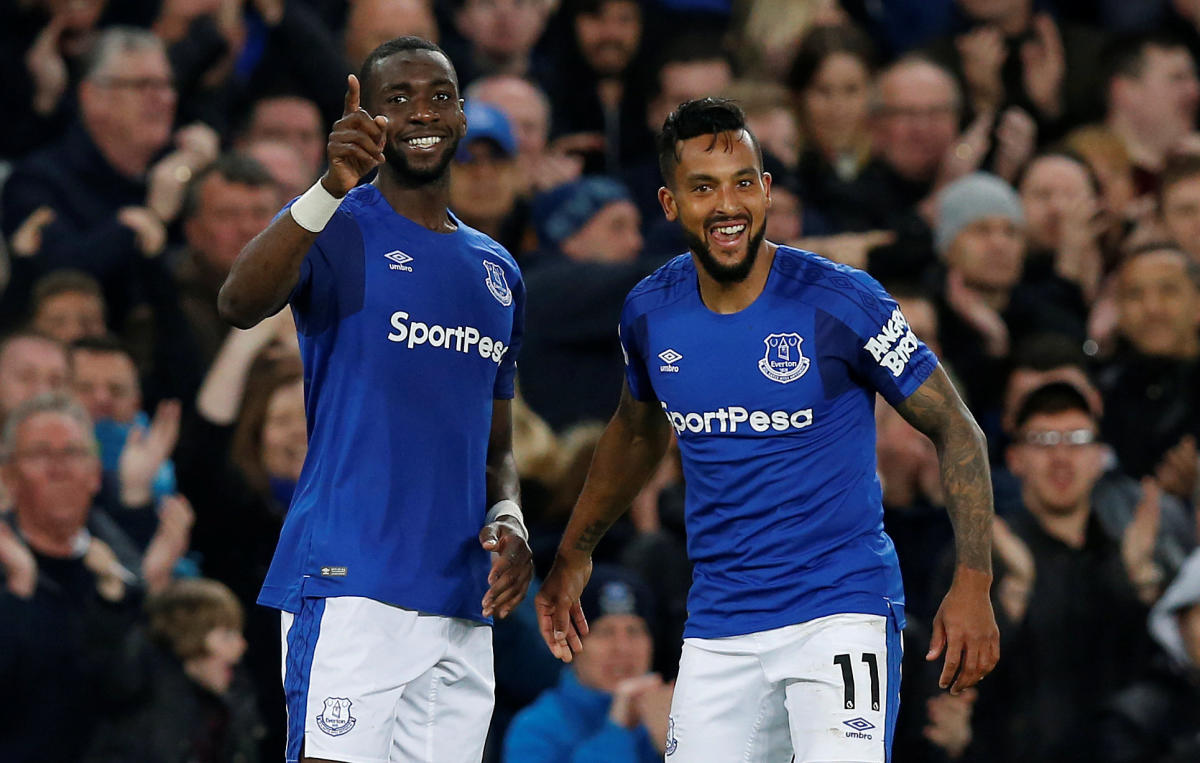 Everton's Theo Walcott (right) celebrates with Yannick Bolasie after scoring against Newcastle United on Monday. REUTERS