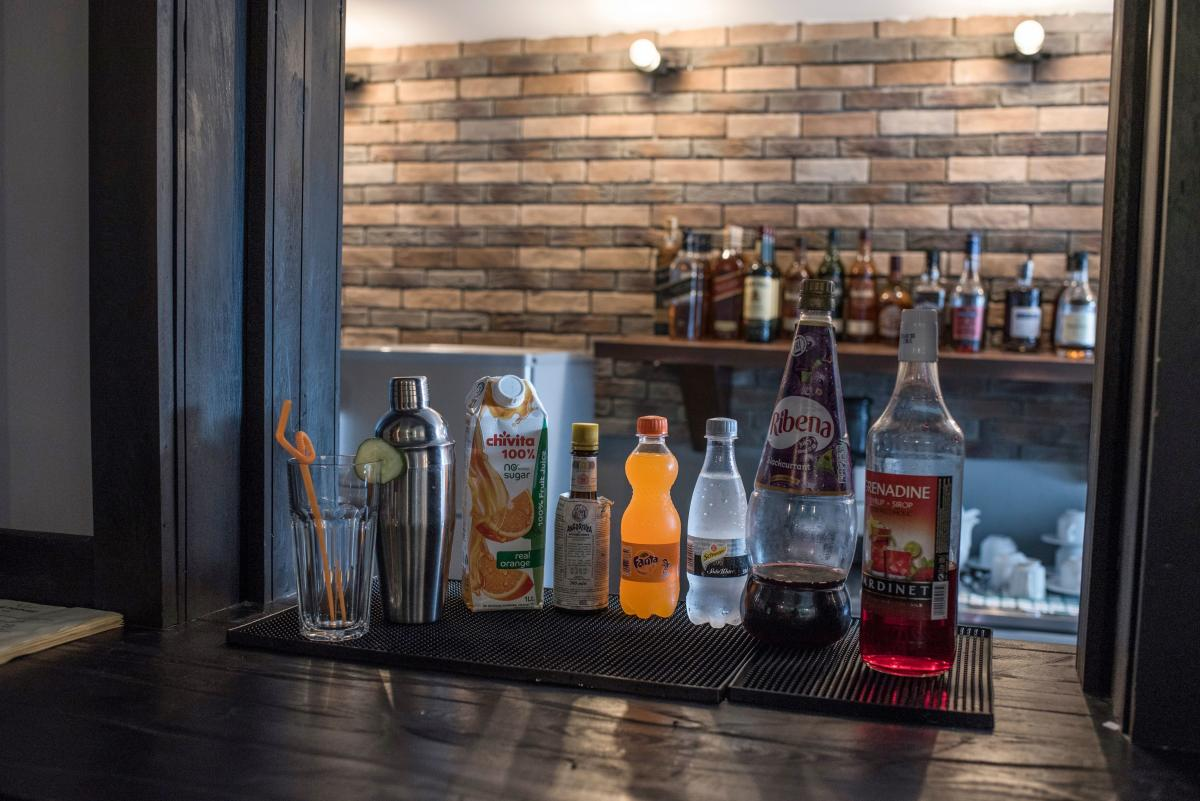 A picture taken on April 10, 2018 shows some of the ingredients of the notorious Nigerian non-alcoholic cocktail called Chapman displayed on the bar of a restaurant in Lagos. Nigerians are known for their love of champagne but it's another fizzy drink --