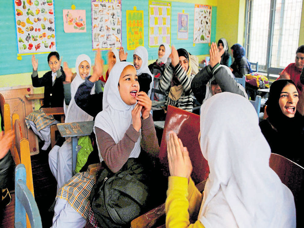 Schools reopen in Kashmir Valley after eight months