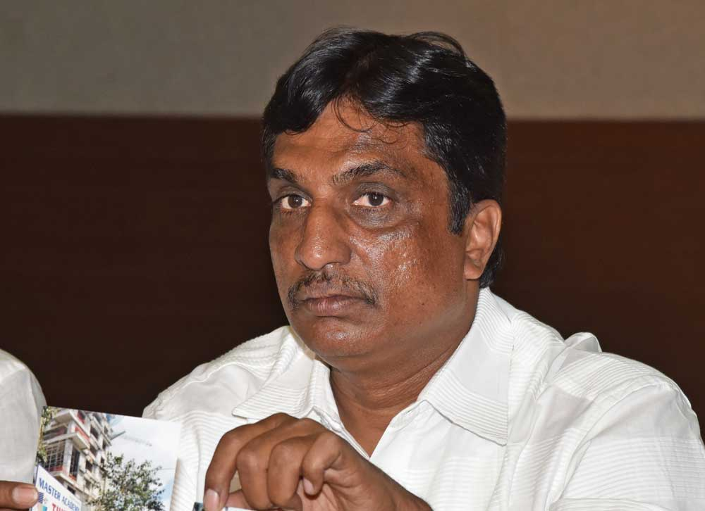 Former corporator accuses real estate firm of encroaching on govt land