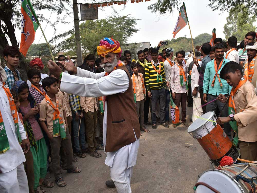 A BJP supporter dance outside the rally. DH photo by Suman Sarkar