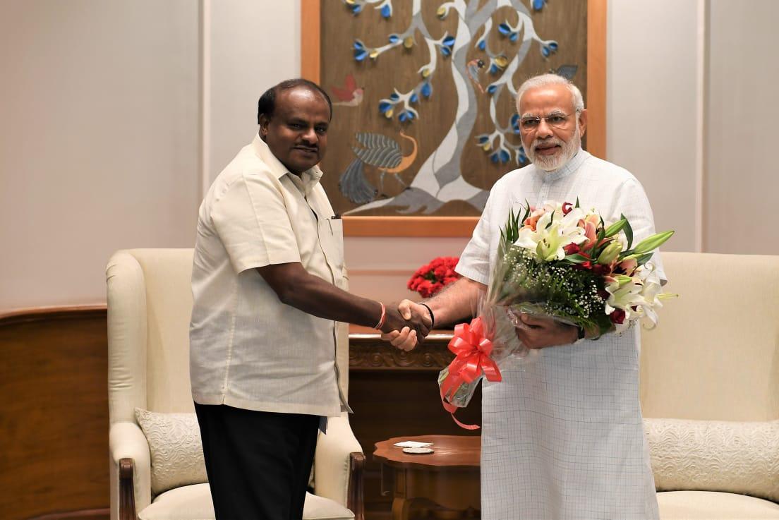 Karnataka Chief Minister H D Kumaraswamy greets Prime Minister Narendra Modi, in New Delhi on Monday.